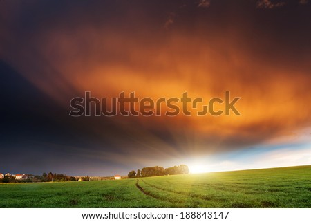 Fantastic field at the sunset. Colorful overcast sky. Ukraine, Europe. Beauty world.