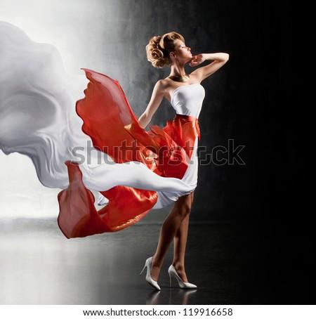 Fantastic girl in fluttering dress - stock photo