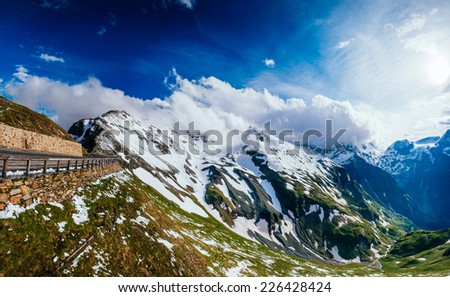 Fantastic landscape almost snow-capped mountains in sunny day  - stock photo