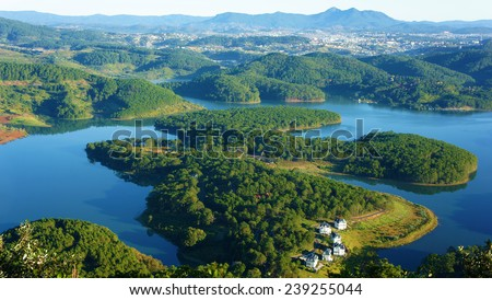 Fantastic landscape of eco lake for travel at Dalat, Viet Nam, fresh atmosphere, villa among forest, impression shape of hill and mountain from high view, wonderful vacation for ecotourism in spring