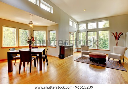 Fantastic modern living room home interior. Dining room. Huge green bright room with modern furniture. - stock photo