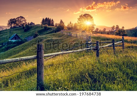 Fantastic morning countryside landscape. Colorful sky. Carpathian, Ukraine, Europe. Beauty world. - stock photo