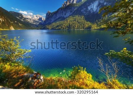 Fantastic morning on mountain lake Gosausee, located in the Austia. Dramatic unusual scene. Alps, Europe. - stock photo