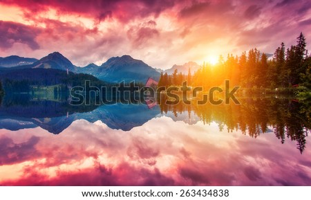 Fantastic mountain lake in National Park High Tatra. Dramatic scenery. Strbske pleso, Slovakia, Europe. Beauty world. Soft filtered and vintage effect. Instagram toning. Double exposure effect. - stock photo