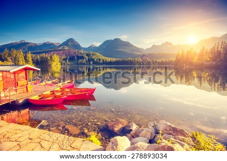Fantastic mountain lake in National Park High Tatra. Strbske pleso, Slovakia, Europe. Dramatic unusual scene. Beauty world. Retro and vintage style, soft filter. Instagram toning effect. - stock photo