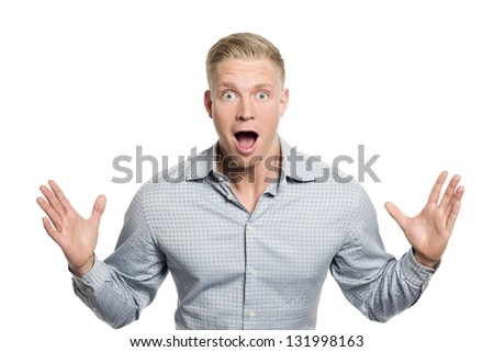 Fantastic news: Amazed businessman with hands up suggesting surprise isolated on white background.