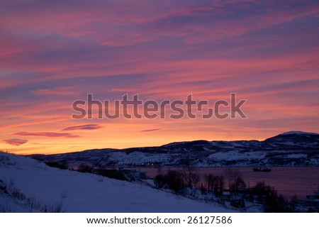 fantastic pink sunset in arctic region of Russia: Kola gulf in winter - stock photo