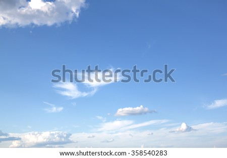 Fantastic soft white clouds against blue sky background.