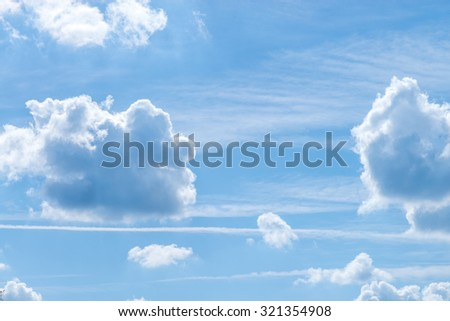 Fantastic soft white clouds against blue sky in sunny summer day - stock photo