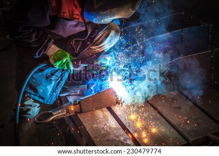 Fantastic sparks during MIG welding  - stock photo