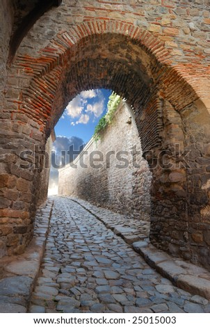 fantastic stone passage in an ancient stronghold - stock photo