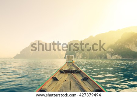 Fantastic sunlight over the lake,Front View boat,Retro and vintage style, soft filter. Toning effect. - stock photo