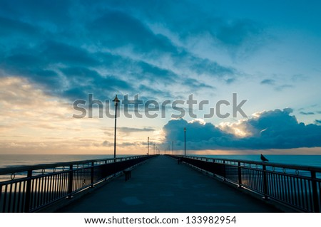 Fantastic sunrise over Pacific ocean at New Brighton Pier, Christchurch, New Zealand - stock photo