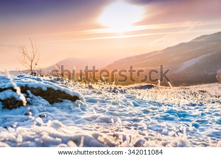 Fantastic sunset in the winter mountains. Beautiful winter landscape. Selective focus - stock photo