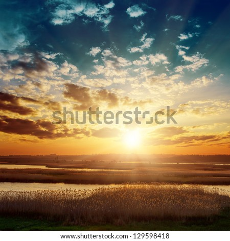 fantastic sunset over river - stock photo
