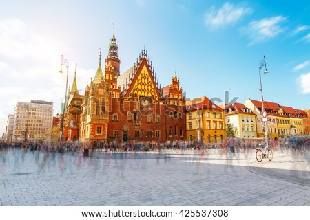 Fantastic view of the ancient city hall Wroclaw (Ratusz WrocÃ??awski) on a sunny day. Picturesque scene. Location famous Market Square, Poland, Europe. Historical capital of Silesia. Beauty world. - stock photo