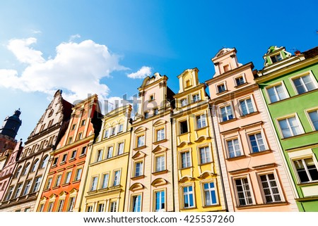 Fantastic view of the ancient homes on a sunny day. Gorgeous picture and picturesque scene. Location famous Market Square in Wroclaw, Poland, Europe. Historical capital of Silesia. Beauty world. - stock photo