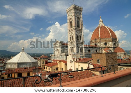 fantastic view of the Basilica di Santa Maria del Fiore ( Basilica of Saint Mary of the Flower ) and   Battistero di San Giovanni  (Baptistery of St. John)  from roof terrace, Florence, Italy, Europe  - stock photo