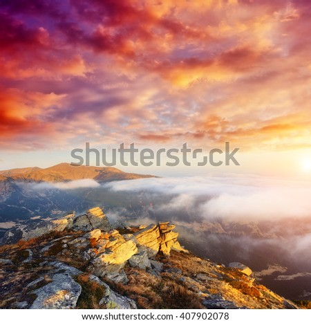 Fantastic view of the foggy hill and cloudy sky which glowing by sunlight. Dramatic and picturesque morning scene. Location place Carpathian, Ukraine, Europe. Beauty world. Soft filter effect. - stock photo