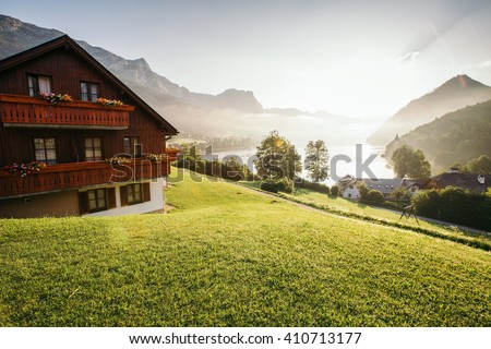 Fantastic views of the morning green garden that glows under sunlight. Dramatic scene. Location: resort Grundlsee, Liezen District of Styria, Austria, Alps. Europe. Beauty world. Instagram effect.