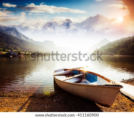 Fantastic views of the morning lake glowing by sunlight. Dramatic and picturesque scene. Location: resort Grundlsee, Liezen District of Styria, Austria, Alps. Europe. Beauty world. Instagram effect. - stock photo