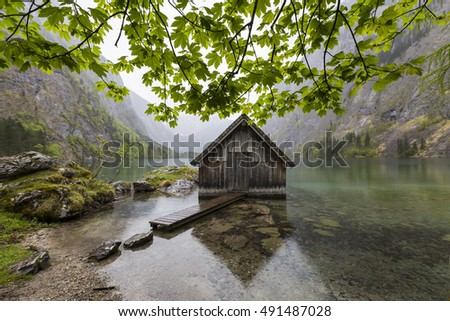 Fantastic views of the turquoise Lake Obersee under sunlight. Dramatic and picturesque scene. Location famous resort: Nafels, Mt. Brunnelistock, Swiss Alps. Europe. Artistic picture. Beauty world.