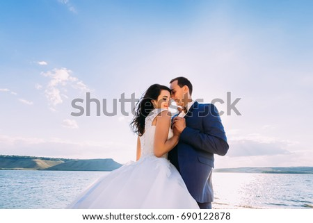 Fantastic wedding couple hugging at the sea. Holidays, vacation, love concept