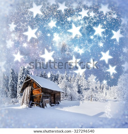 fantastic winter landscape. Chalet under the stars. background with some soft highlights and snow flakes