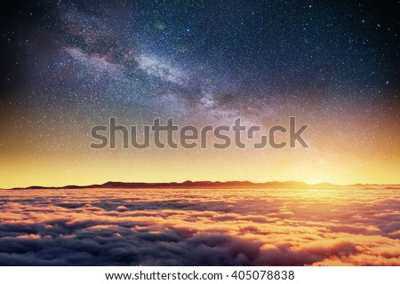 Fantastic winter meteor rain and mountains in the mist. Cumulus fantastic fog in the morning sky.Carpathian, Ukraine, Europe.