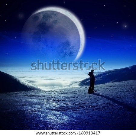 Fantastic winter night landscape in high mountains over the clouds, Woman watching majestic huge moon