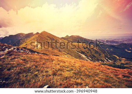 Fantasy and colorfull nature mountains landscape. Nature conceptual image. Instagram vintage sunburst picture. - stock photo