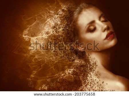 Fantasy. Enigmatic Woman with Golden Painted Skin. Metallic Splash - stock photo