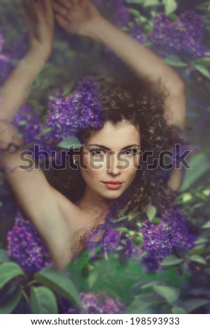 fantasy forest fairy surrounded by flowers