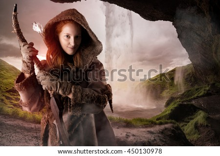 Fantasy girl archer in a waterfall with bow