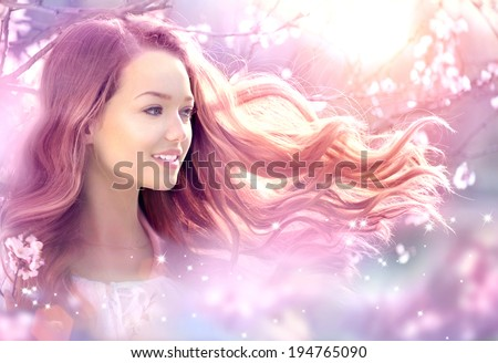 Fantasy Girl with long pink blowing hair. Spring or summer beauty teen girl with flowers. Fashion Art Beauty Portrait. Beautiful Girl in Fantasy Magical Spring Garden - stock photo