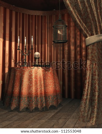 Fantasy gypsy tent with a cage, table, candelabra and crystal ball - stock photo