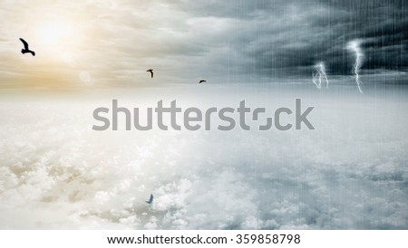 Fantasy opposite weather sky, beautiful sun and ominous stormy sky clouds with infinity conception for composite  - stock photo