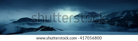 Fantasy photo of a mountains in the mist at evening and white lights. Magic and scenic landscape photo - stock photo