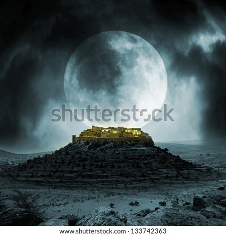 Fantasy stronghold on a hill with full moon