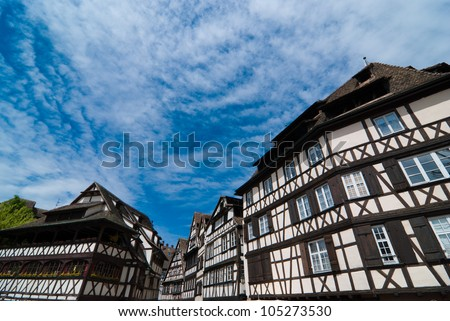 Fantasy style half-timbered houses against blue sky, Strasbourg, Alsace, France