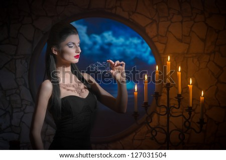 Fantasy style portrait of demonic woman with lacy mask - stock photo