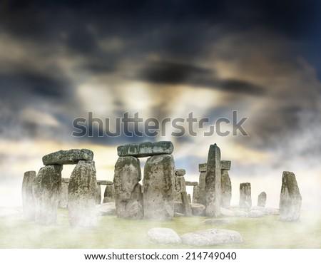 Fantasy sunrise at Stonehenge with dramatic sky - stock photo