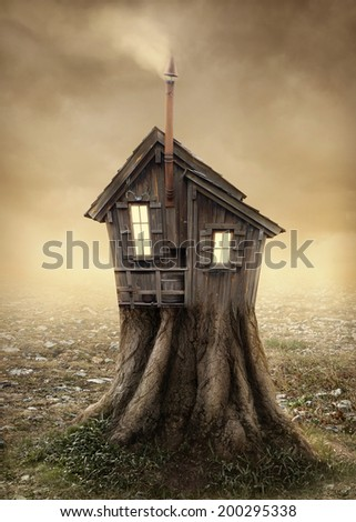 Fantasy tree house in the meadow - stock photo