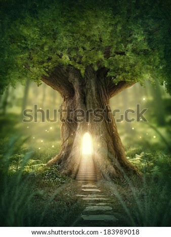 Fantasy tree house with light in the forest - stock photo