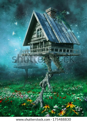 Fantasy witch's cottage on a meadow with flowers - stock photo