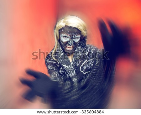 Fantasy woman. Witch, zombie, skeleton. Mysticism. Dead bride woman in skull face dark mask. Halloween. Woman skeleton on a red black background. Halloween, make up skull. Magic sorceress - concept. - stock photo