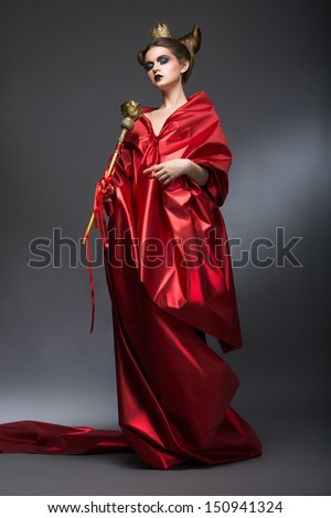 Fantasy.  Woman Wizard in Red Pallium with Scepter. Mystery - stock photo