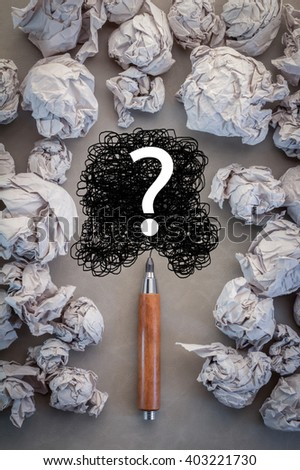 faq concept with crumpled paper and question mark drawing on grey blackground.jpg - stock photo