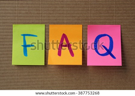 FAQ (Frequently Asked Questions) acronym on colorful sticky note - stock photo