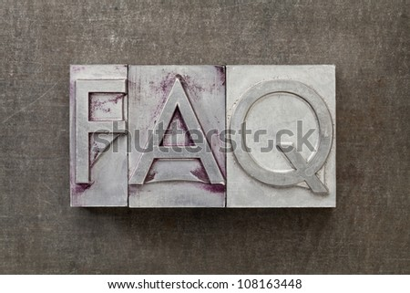 FAQ (frequently asked questions) acronym - text in vintage letterpress metal type against a grunge steel sheet - stock photo